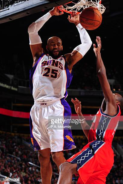 Vince Carter of the Phoenix Suns dunks against the New Jersey Nets in an NBA game played on January 12 2011 at US Airways Center in Phoenix Arizona...