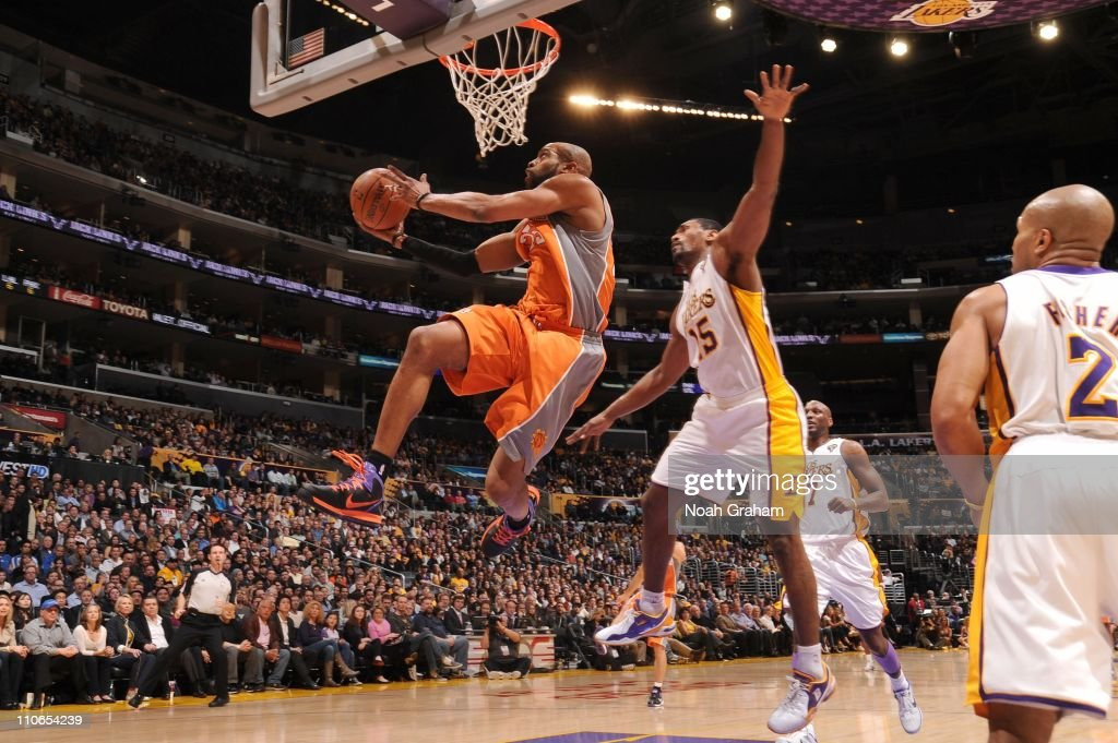 Vince Carter of the Phoenix Suns goes up for a shot against Ron Artest of the Los Angeles Lakers at Staples Center on March 22 2011 in Los Angeles...