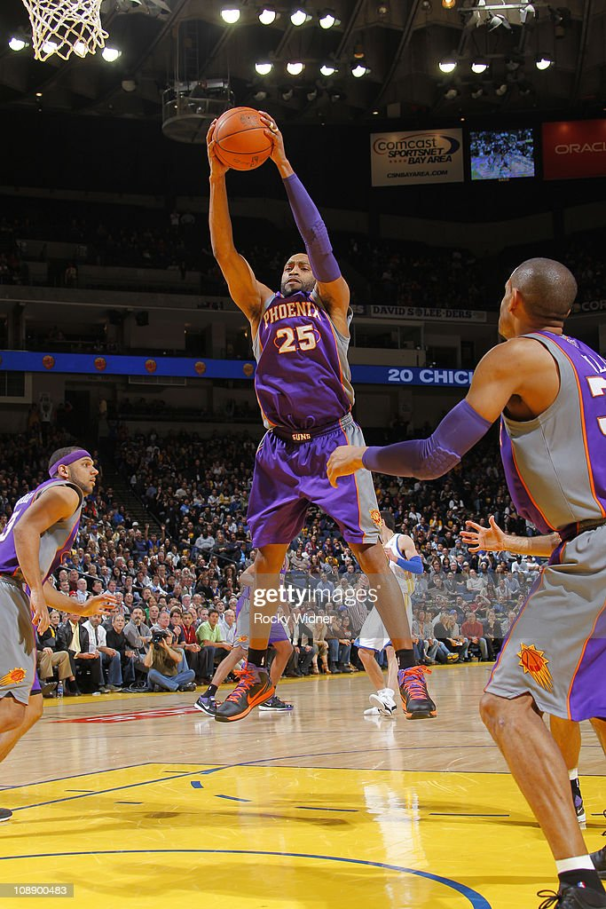 <a gi-track='captionPersonalityLinkClicked' href=/galleries/search?phrase=Vince+Carter&family=editorial&specificpeople=201488 ng-click='$event.stopPropagation()'>Vince Carter</a> #25 of the Phoenix Suns pulls down a rebound against the Golden State Warriors on February 7, 2011 at Oracle Arena in Oakland, California.