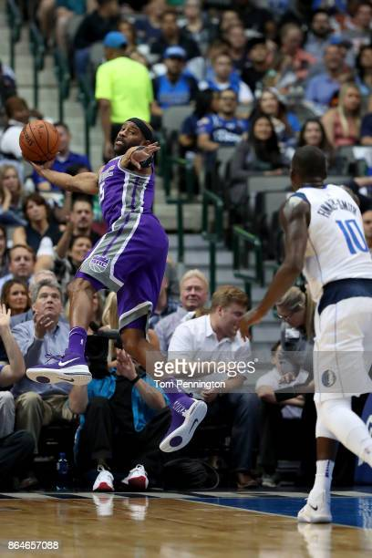 Vince Carter of the Sacramento Kings dives for the ball against Dorian FinneySmith of the Dallas Mavericks at American Airlines Center on October 20...