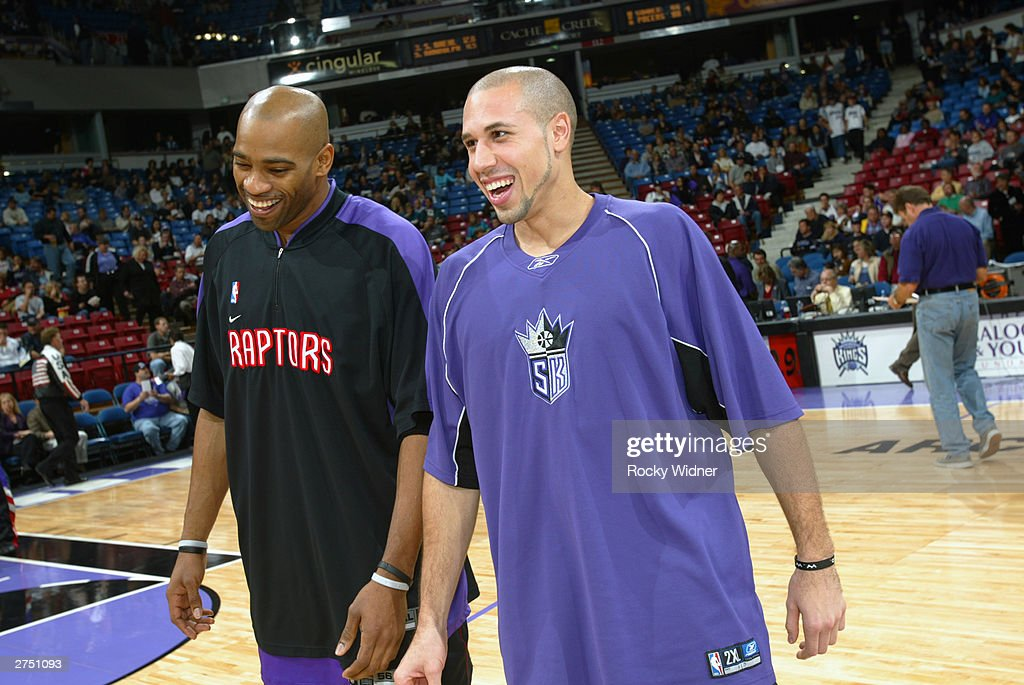 Vince Carter #15 of the Toronto Raptors and Mike Bibby #10 of the Sacramento Kings share a laugh before the game at Arco Arena on November 14, 2003 in Sacramento, California. The Kings won 94-64.