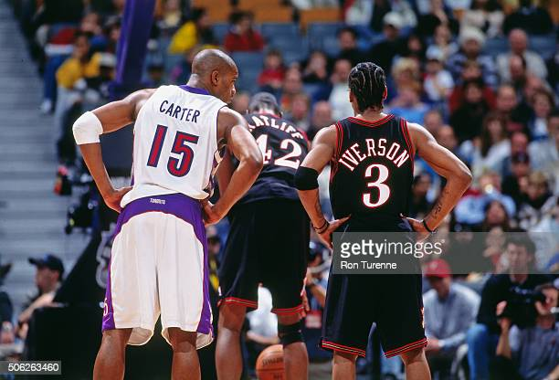 Vince Carter of the Toronto Raptors chats with Allen Iverson of the Philadelphia 76ers on November 14 1999 at the Air Canada Centre in Toronto...