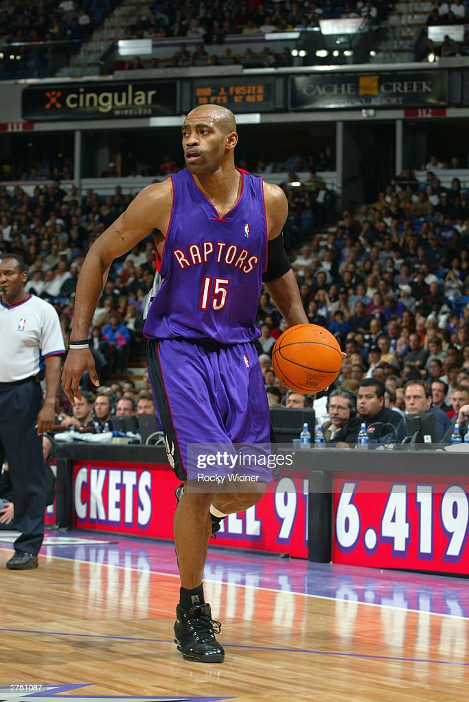 Vince Carter #15 of the Toronto Raptors dribbles against the Sacramento Kings during the game at Arco Arena on November 14, 2003 in Sacramento, California. The Kings won 94-64.