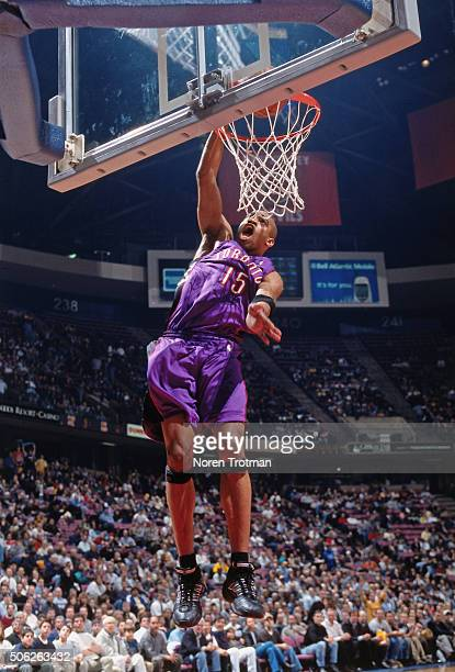 Vince Carter of the Toronto Raptors dunks against the New Jersey Nets on March 30 2000 at Continental Airlines Arena in East Rutherford New Jersey...