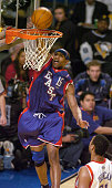 Vince Carter of the Toronto Raptors dunks during the NBA AllStar Game at the Staples Center in Los Angeles California on Sunday February 15 2004 The...