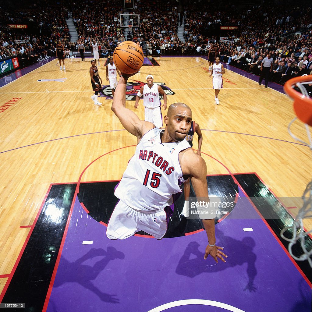 <a gi-track='captionPersonalityLinkClicked' href=/galleries/search?phrase=Vince+Carter&family=editorial&specificpeople=201488 ng-click='$event.stopPropagation()'>Vince Carter</a> #15 of the Toronto Raptors dunks the ball against the Denver Nuggets at Air Canada Centre in Toronto, Canada circa 2001.
