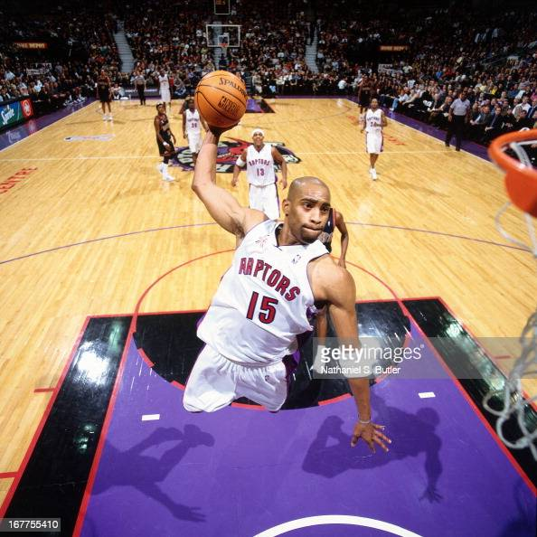 Vince Carter of the Toronto Raptors dunks the ball against the Denver Nuggets at Air Canada Centre in Toronto Canada circa 2001 NOTE TO USER User...
