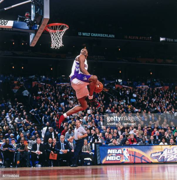 Vince Carter of the Toronto Raptors dunks the ball during the 2000 NBA Slam Dunk Contest as part of NBA AllStar weekend at The Arena in Oakland on...