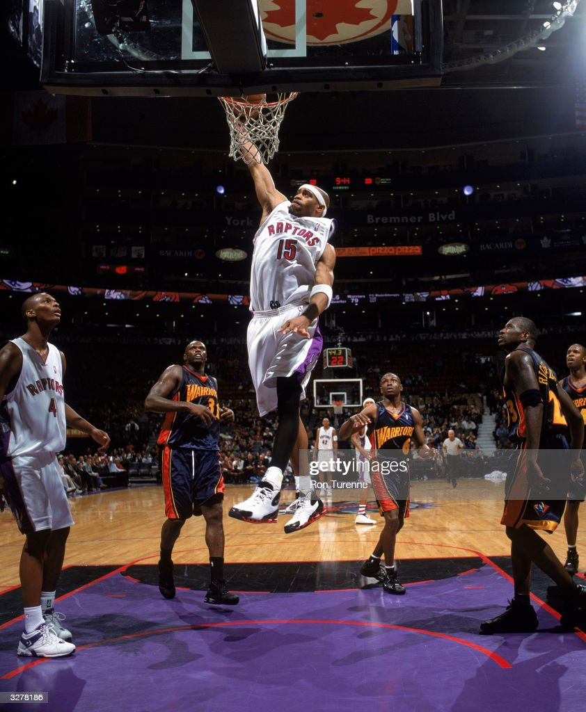 Vince Carter of the Toronto Raptors dunks the ball during the game against the Golden State Warriors at the Air Canada Centre on March 31 2004 in...
