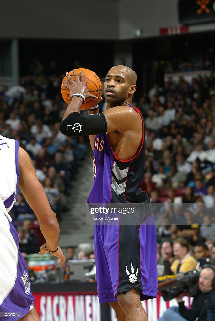 Vince Carter #15 of the Toronto Raptors looks to pass the ball against the Sacramento Kings during the game at Arco Arena on November 14, 2003 in Sacramento, California. The Kings won 94-64.