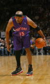 Vince Carter of the Toronto Raptors looks to set up a play against the Philadelphia Sixers during the preseason game at the John Labatt Centre on...