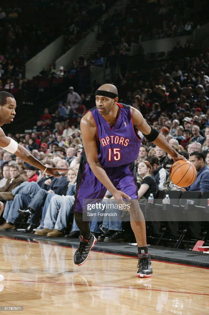 Vince Carter of the Toronto Raptors moves the ball against the Portland Trail Blazers during the game at the Rose Garden on November 13 2004 in...