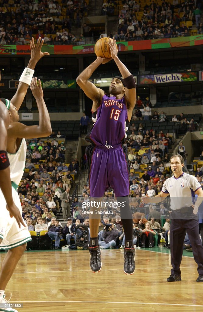 Vince Carter of the Toronto Raptors shoots against the Boston Celtics during a game on December 3 2004 at the Fleet Center in Boston Massachusetts...
