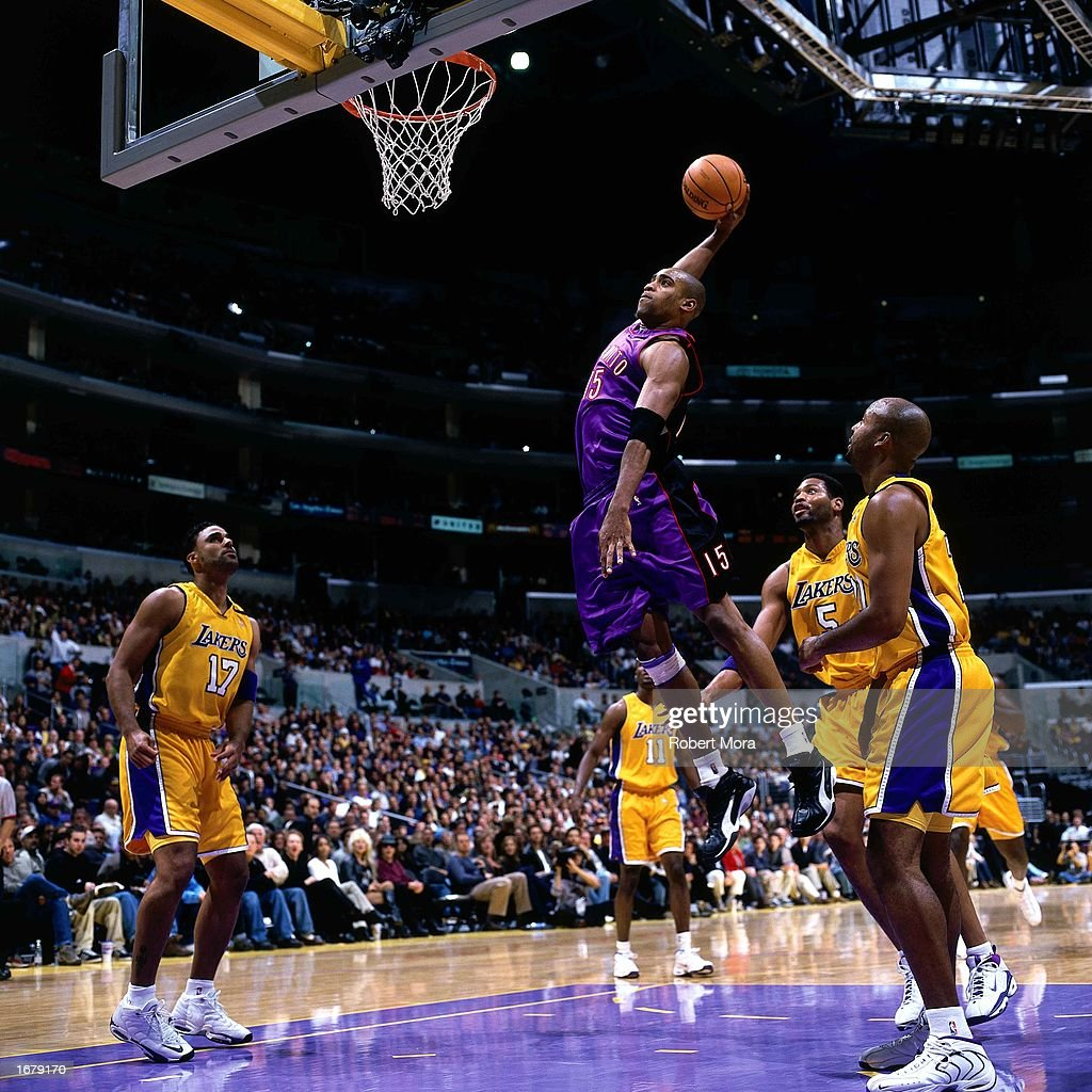 Vince Carter of the Toronto Raptors soars in for a slam dunk during the NBA game against the Los Angeles Lakers at the Staples Center on November 21...