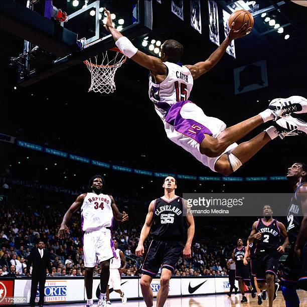 Vince Carter of the Toronto Raptors soars in for a slam dunk during the 2000 NBA game against the Cleveland Cavaliers in Toronto Canada NOTE TO USER...