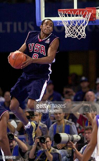 Vince Carter of the United States soars in the air before dunking 01 October 2000 during the men's gold medal match in the Sydney 2000 Olympics at...