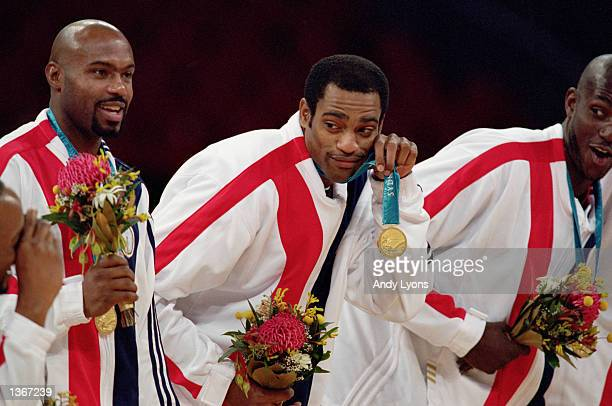 Vince Carter of the USA dangles his gold medal as he poses for a photo after the USA won the Mens Basketball Final against France on October 1 2000...