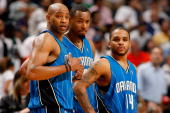 Vince Carter Rashard Lewis and Jameer Nelson of the Orlando Magic look across the court in Game Four of the Eastern Conference Quarterfinals against...