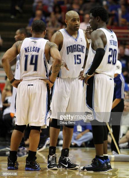 Vince Carter talks with Mickael Pietrus and Jameer Nelson of the Orlando Magic during a break in play against the Atlanta Hawks in Game Two of the...
