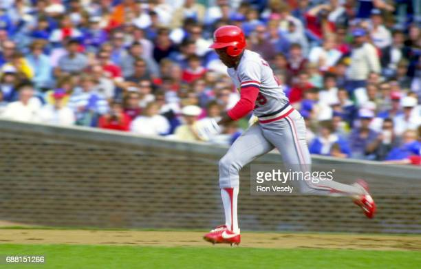 Vince Coleman of the St Louis Cardinals attempts to steal second base during an MLB game versus the Chicago Cubs at Wrigley Field in Chicago Illinois...