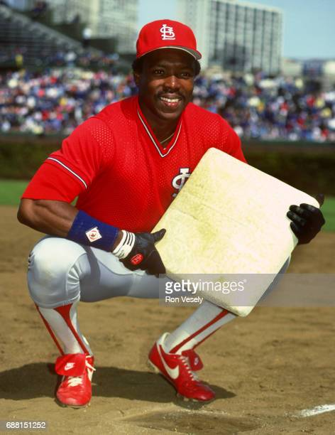 Vince Coleman of the St Louis Cardinals poses for a portrait while holding a base prior to an MLB game versus the Chicago Cubs at Wrigley Field in...
