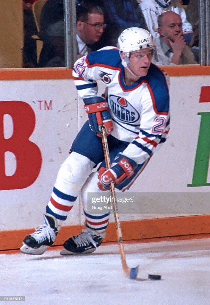 Vince Damphousse #21 of the Edmonton Oilers takes a shot against the Toronto Maple Leafs during NHL game action on February 16, 1992 at Maple Leaf Gardens in Toronto, Ontario, Canada.
