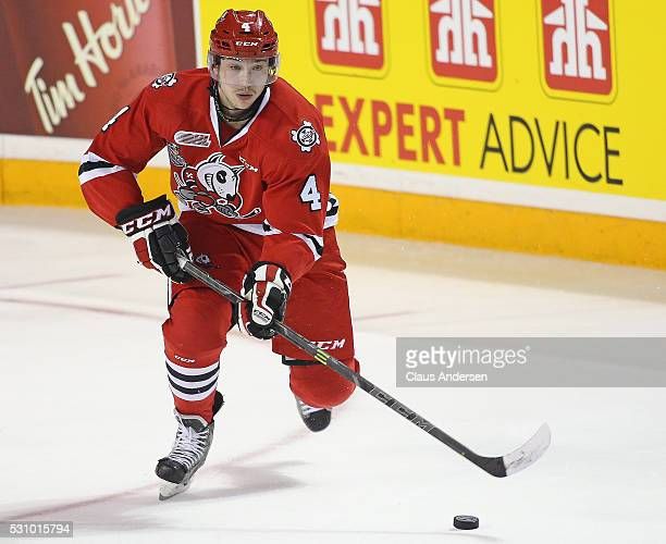 Vince Dunn of the Niagara IceDogs skates with the puck against the London Knights during Game Four of the OHL Championship final for the JRoss...