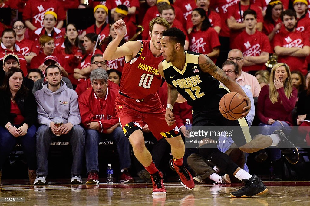 Vince Edwards #12 of the Purdue Boilermakers dribbles the ball against <a gi-track='captionPersonalityLinkClicked' href=/galleries/search?phrase=Jake+Layman&family=editorial&specificpeople=9973489 ng-click='$event.stopPropagation()'>Jake Layman</a> #10 of the Maryland Terrapins in the second half during their game at Xfinity Center on February 6, 2016 in College Park, Maryland. The Maryland Terrapins defeated the Purdue Boilermakers 72-61.