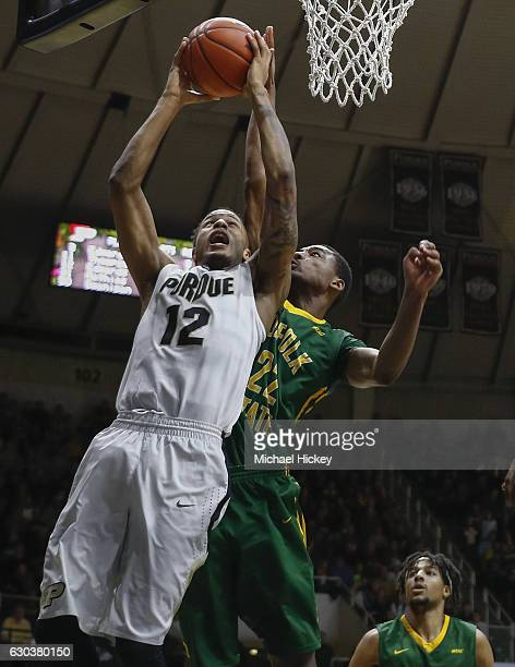 Vince Edwards of the Purdue Boilermakers shoots the ball against Alex Long of the Norfolk State Spartans at Mackey Arena on December 21 2016 in West...