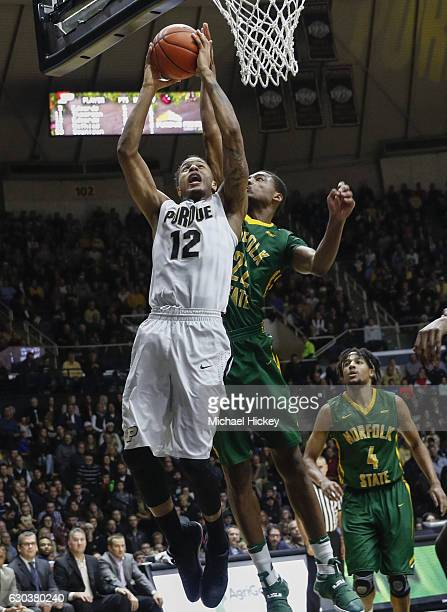 Vince Edwards of the Purdue Boilermakers shoots the ball as Alex Long of the Norfolk State Spartans defends at Mackey Arena on December 21 2016 in...
