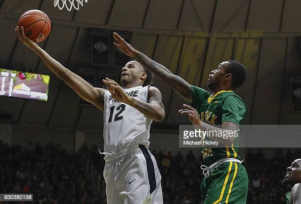Vince Edwards of the Purdue Boilermakers shoots the ball as Carrington Ward of the Norfolk State Spartans trails behind at Mackey Arena on December...