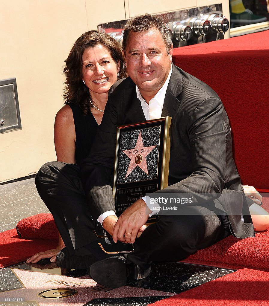 Vince Gill and Amy Grant attend Gill's induction into the Hollywood Walk of Fame on September 6 2012 in Hollywood California