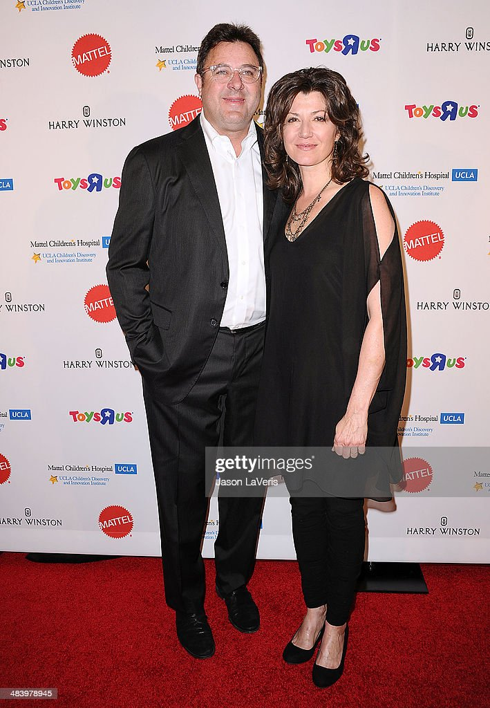 Vince Gill and Amy Grant attend the Kaleidoscope Ball at Beverly Hills Hotel on April 10 2014 in Beverly Hills California