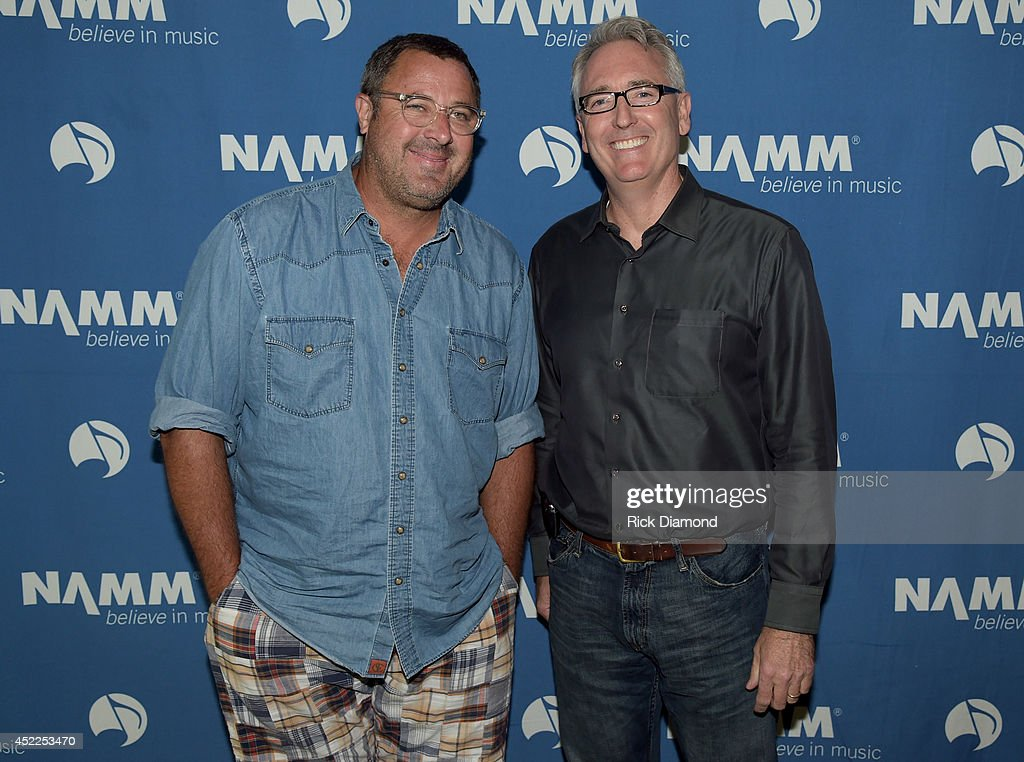 Vince Gill and Joe Lamond President CEO NAMM backstage before Vince Gill Hosts 'Insight Iconic Artists And The Gear That Inspires Them' To Kick Off...