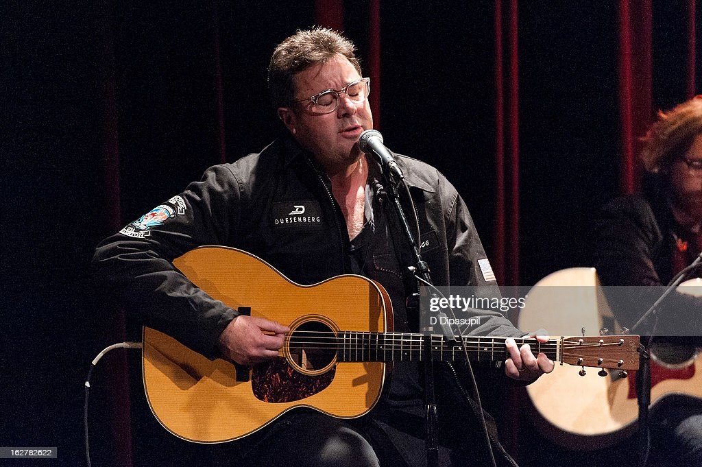 <a gi-track='captionPersonalityLinkClicked' href=/galleries/search?phrase=Vince+Gill&family=editorial&specificpeople=215309 ng-click='$event.stopPropagation()'>Vince Gill</a> performs on stage during the All For The Hall New York concert benefiting the Country Music Hall Of Fame at Best Buy Theater on February 26, 2013 in New York City.