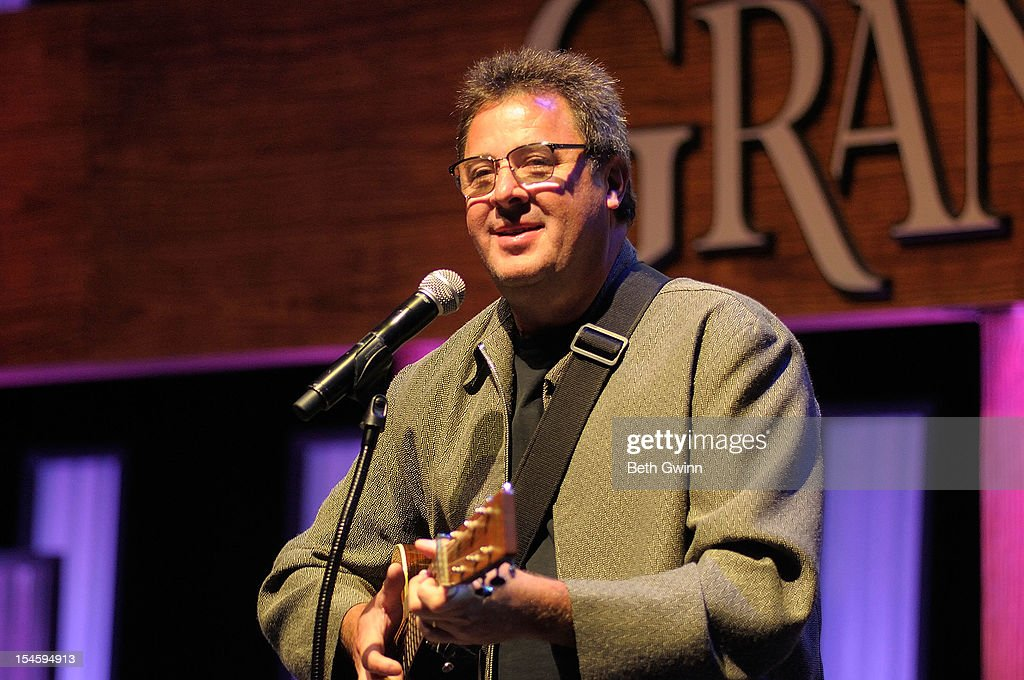 <a gi-track='captionPersonalityLinkClicked' href=/galleries/search?phrase=Vince+Gill&family=editorial&specificpeople=215309 ng-click='$event.stopPropagation()'>Vince Gill</a> plays at the Center Stage at The Opry celebrating Minnie Pearl's 100th at The Grand Ole Opry on October 22, 2012 in Nashville, Tennessee.