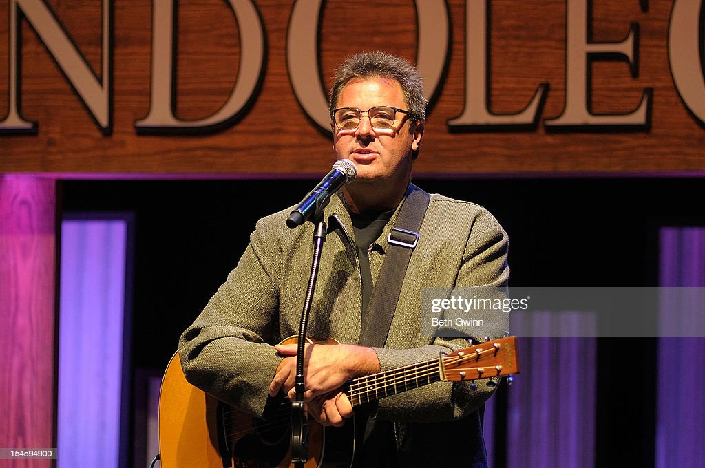 <a gi-track='captionPersonalityLinkClicked' href=/galleries/search?phrase=Vince+Gill&family=editorial&specificpeople=215309 ng-click='$event.stopPropagation()'>Vince Gill</a> plays the Center Stage at The Opry celebrating Minnie Pearl's 100th at The Grand Ole Opry on October 22, 2012 in Nashville, Tennessee.