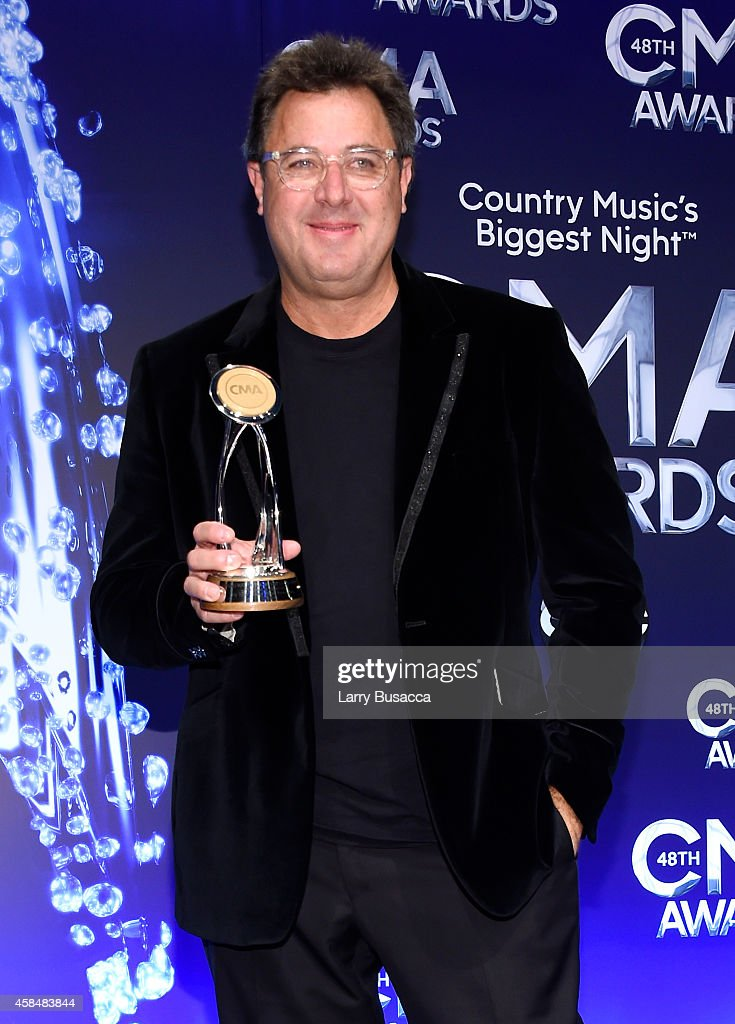 Vince Gill poses in the press room with his Irving Waugh Award of Excellence at the 48th annual CMA Awards at the Bridgestone Arena on November 5...