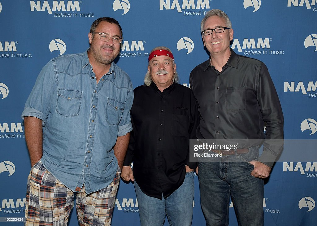 Vince Gill Tom Bedell of Two Old Hippies and Joe Lamond President CEO NAMM backstage before Vince Gill Hosts 'Insight Iconic Artists And The Gear...