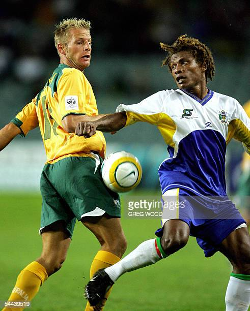 Vince Grella of Australia traps the ball as Francis Wasi of the Solomon Islands is unbalanced during the Oceania World Cup football qualifier against...