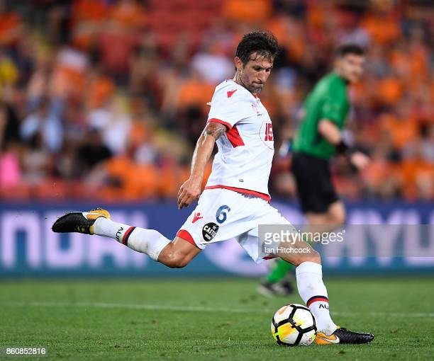 Vince Lia of Adelaide United kicks the ball during the round two ALeague match between the Brisbane Roar and Adelaide United at Suncorp Stadium on...