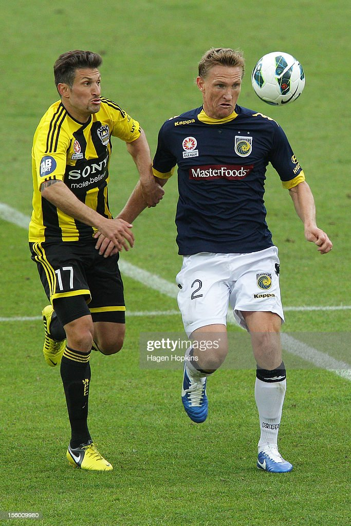 Vince Lia of the Phoenix and Daniel McBreen of the Mariners compete for the ball during the round six A-League match between the Wellington Phoenix and the Central Coast Mariners at Westpac Stadium on November 11, 2012 in Wellington, New Zealand.