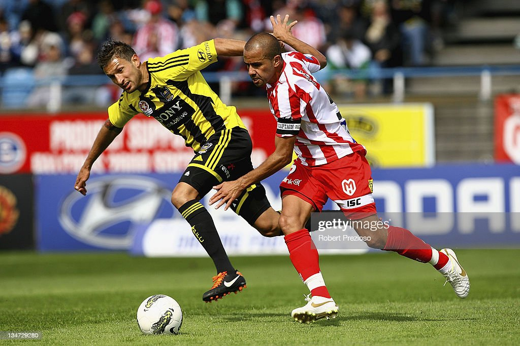 Vince Lia of the Phoenix and Fred of the Heart contest the ball during the round nine A-League match between the Melbourne Heart and the Wellington Phoenix at Latrobe City Sports & Entertainment Complex on December 4, 2011 in Melbourne, Australia.