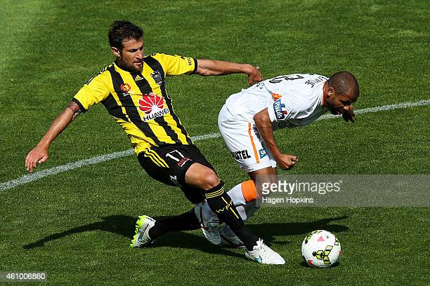 Vince Lia of the Phoenix and Henrique of the Roar compete for the ball during the round 15 ALeague match between the Wellington Phoenix and Brisbane...