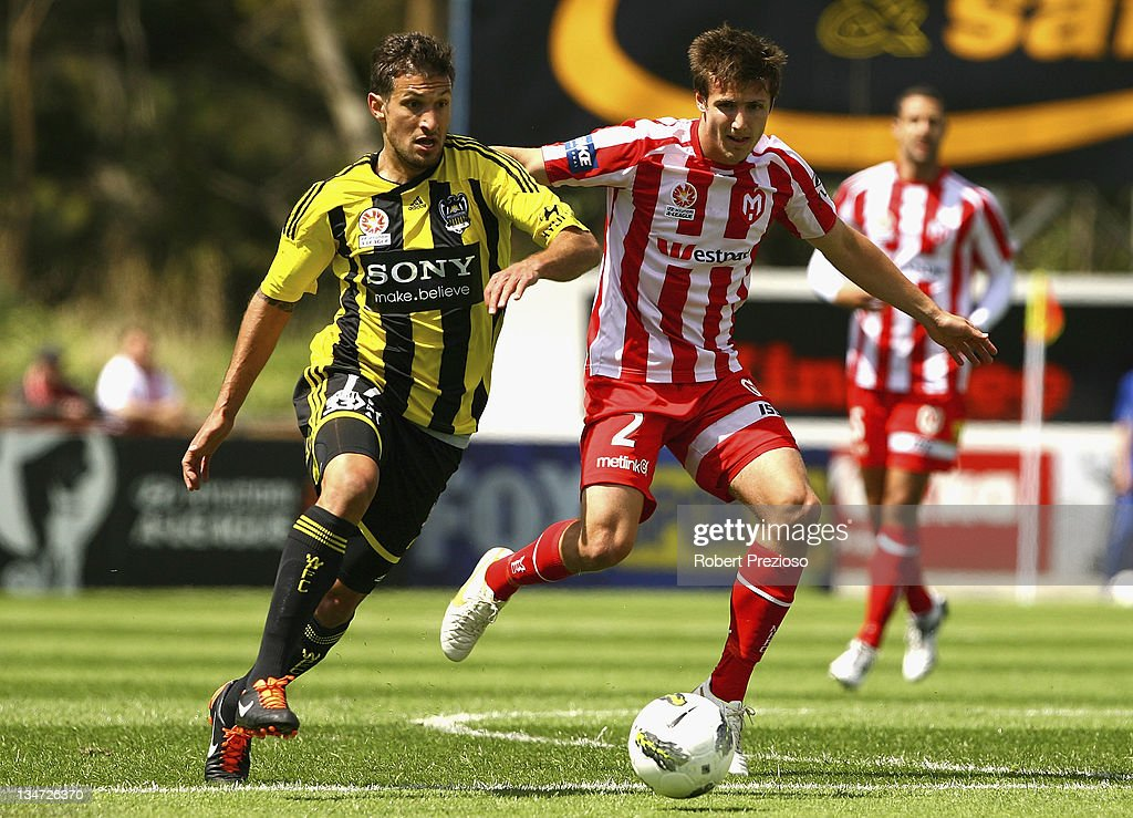 Vince Lia of the Phoenix and Michael Marrone of the Heart contest the ball during the round nine A-League match between the Melbourne Heart and the Wellington Phoenix at Latrobe City Sports & Entertainment Complex on December 4, 2011 in Melbourne, Australia.