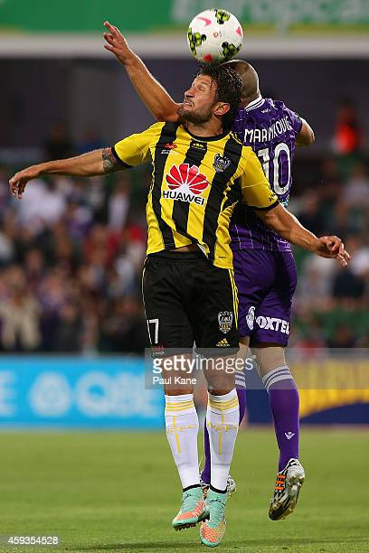 Vince Lia of the Phoenix and Nebojsa Marinkovic of the Glory contest a header during the round seven ALeague match between Perth Glory and Wellington...
