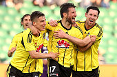 Vince Lia of the Phoenix celebrates with Louis Fenton and Blake Powell of the Phoenix after scoring a goal during the round two ALeague match between...