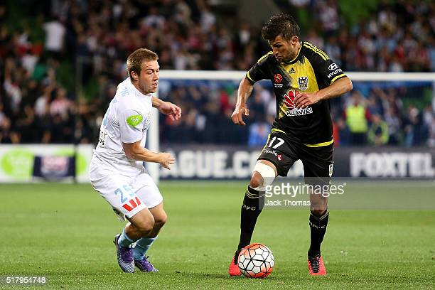 Vince Lia of the Phoenix controls the ball against Jacob Melling of Melbourne City during the round 25 ALeague match between Melbourne City FC and...