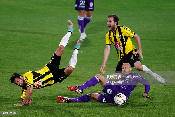 Vince Lia of the Phoenix flies over Ruben Zadkovich of the Glory during the round seven ALeague match between Perth Glory and Wellington Phoenix at...