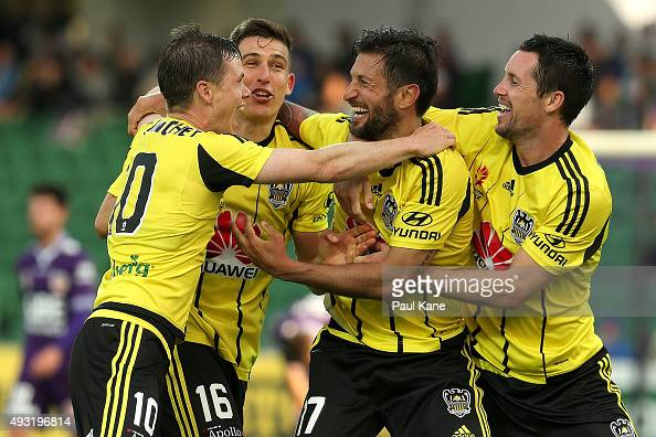 Vince Lia of the Phoenix is congratulated by team mates after scoring a goal during the round two ALeague match between the Perth Glory and...
